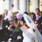 traditional wedding couple with confetti