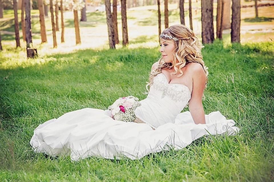 summer bride sitting on grass